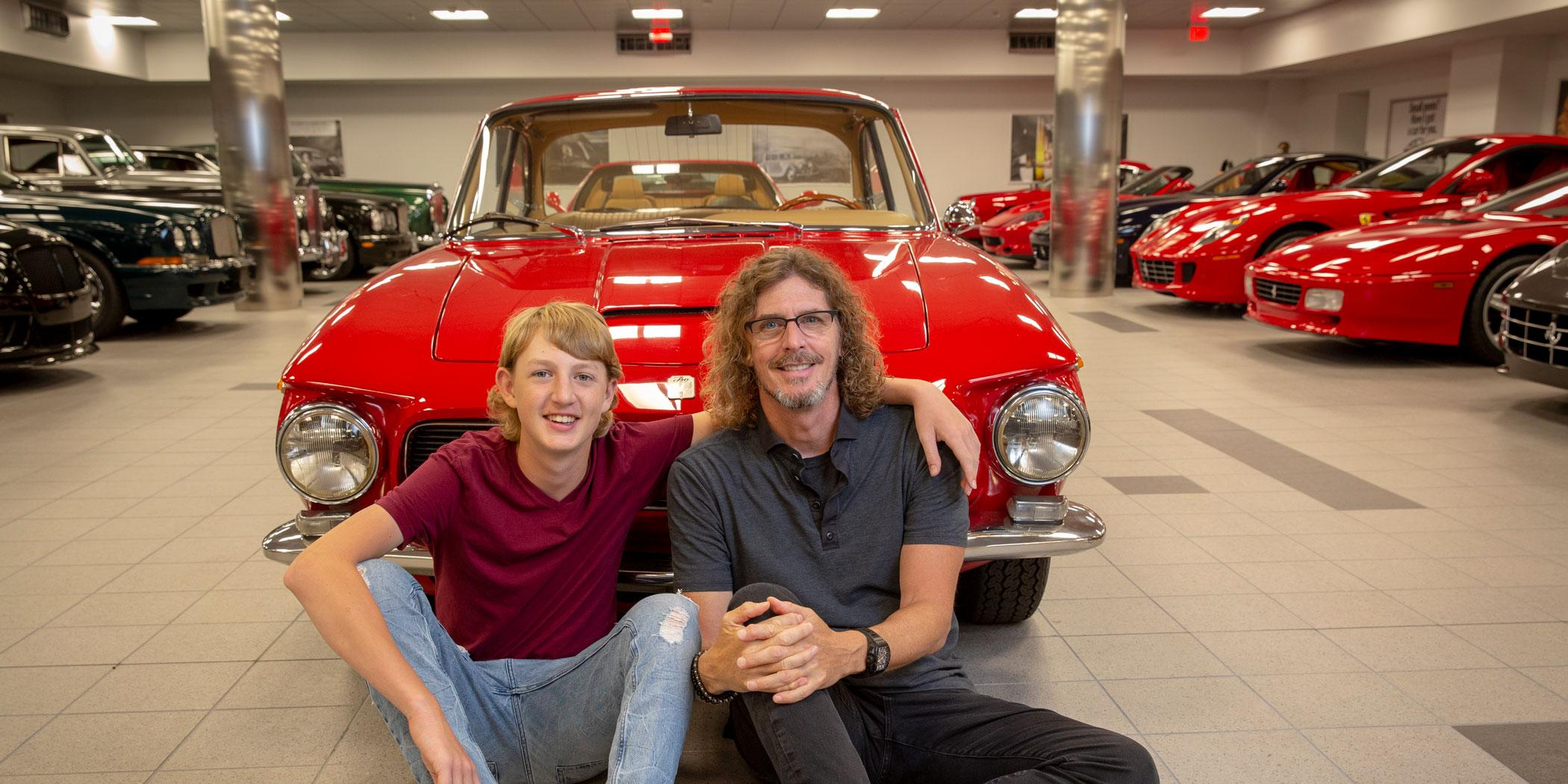 Boch with his son, Alex, at the building where he keeps the majority of his vintage autos. Photo: Bill Bernstein