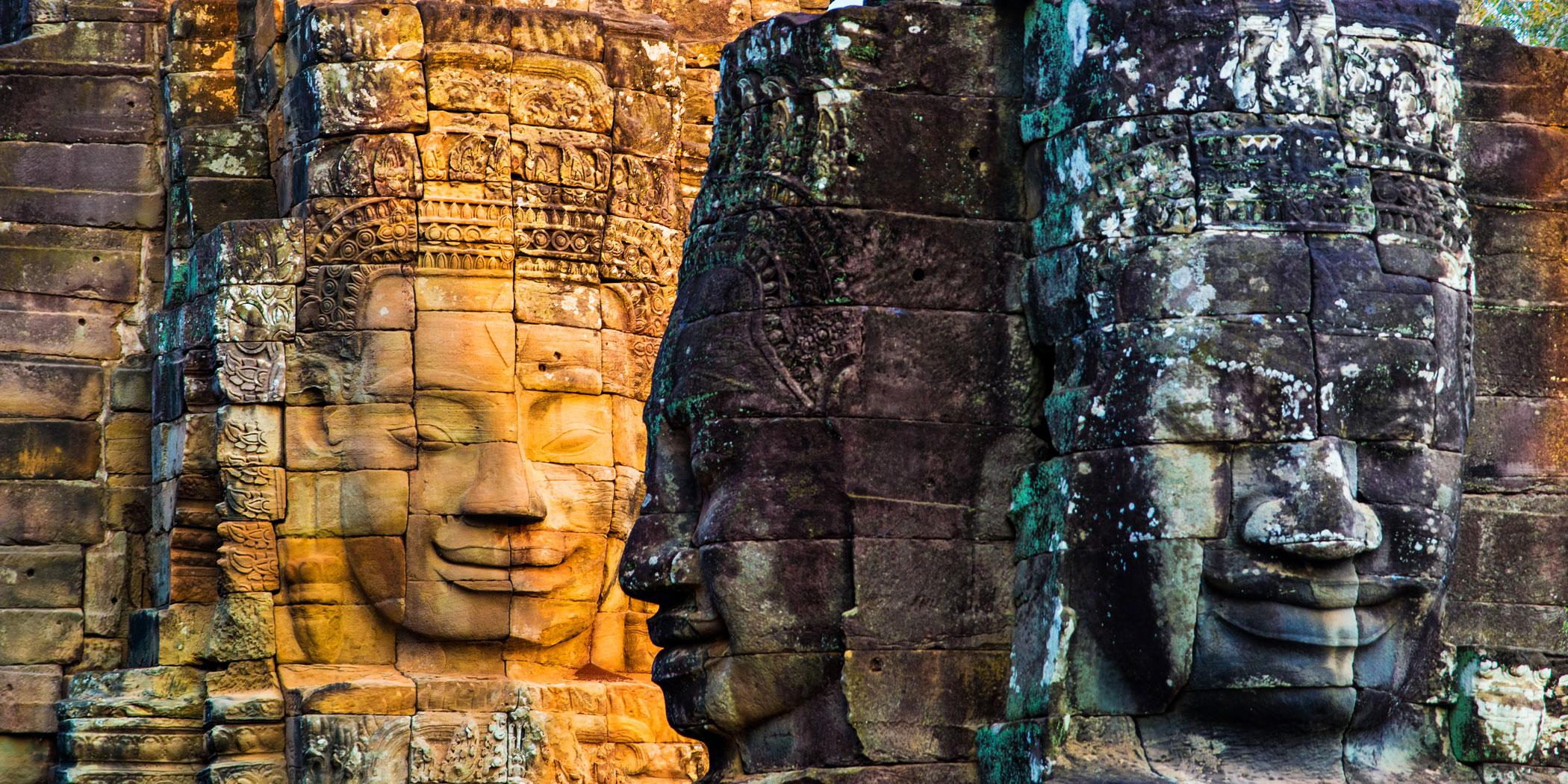 Stone murals and statue at Bayon Temple in Angkor Thom. (Photo: Fotolia)