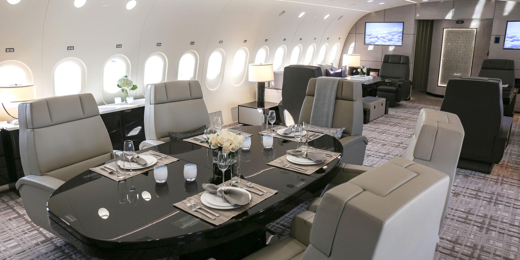 Greenpoint Technologies designed this dining and lounge area in a VVIP 787-8.