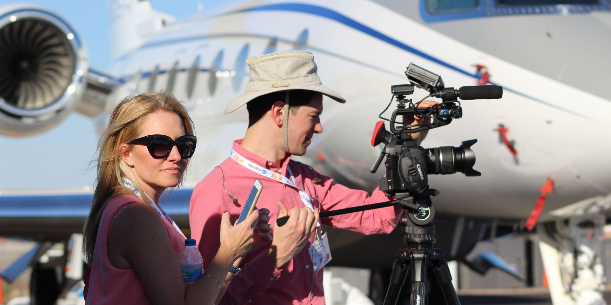 Editorial director Jennifer Leach English and video producer Ian Whelan at a National Business Aviation Association convention.