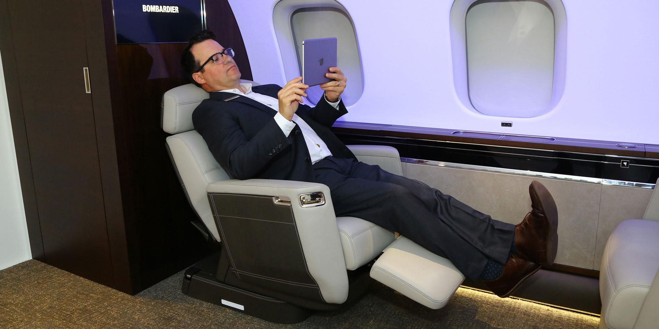 Tim Fagan, Bombardier manager of industrial design, in the Nuage seat Photo: David McIntosh