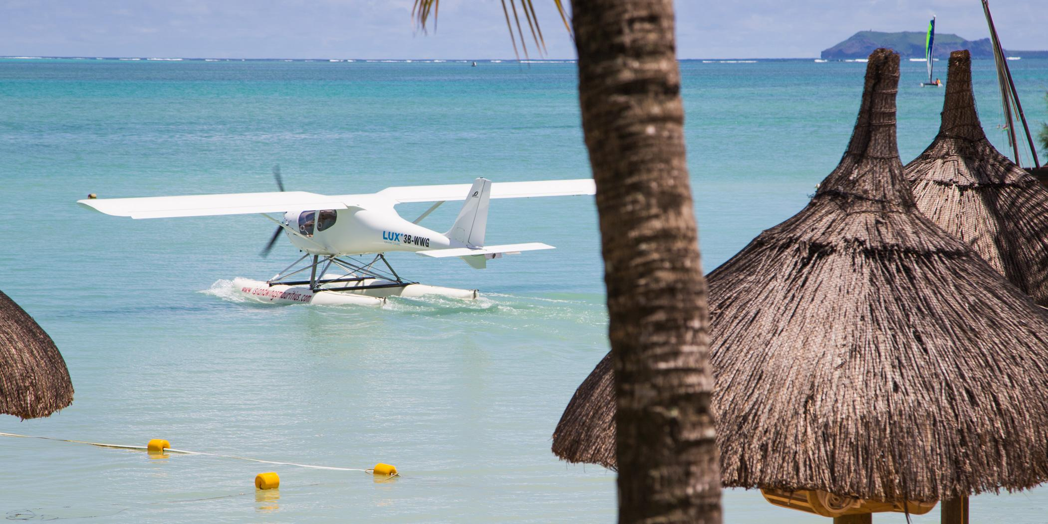 A seaplane parked in front of a resort on the north coast.