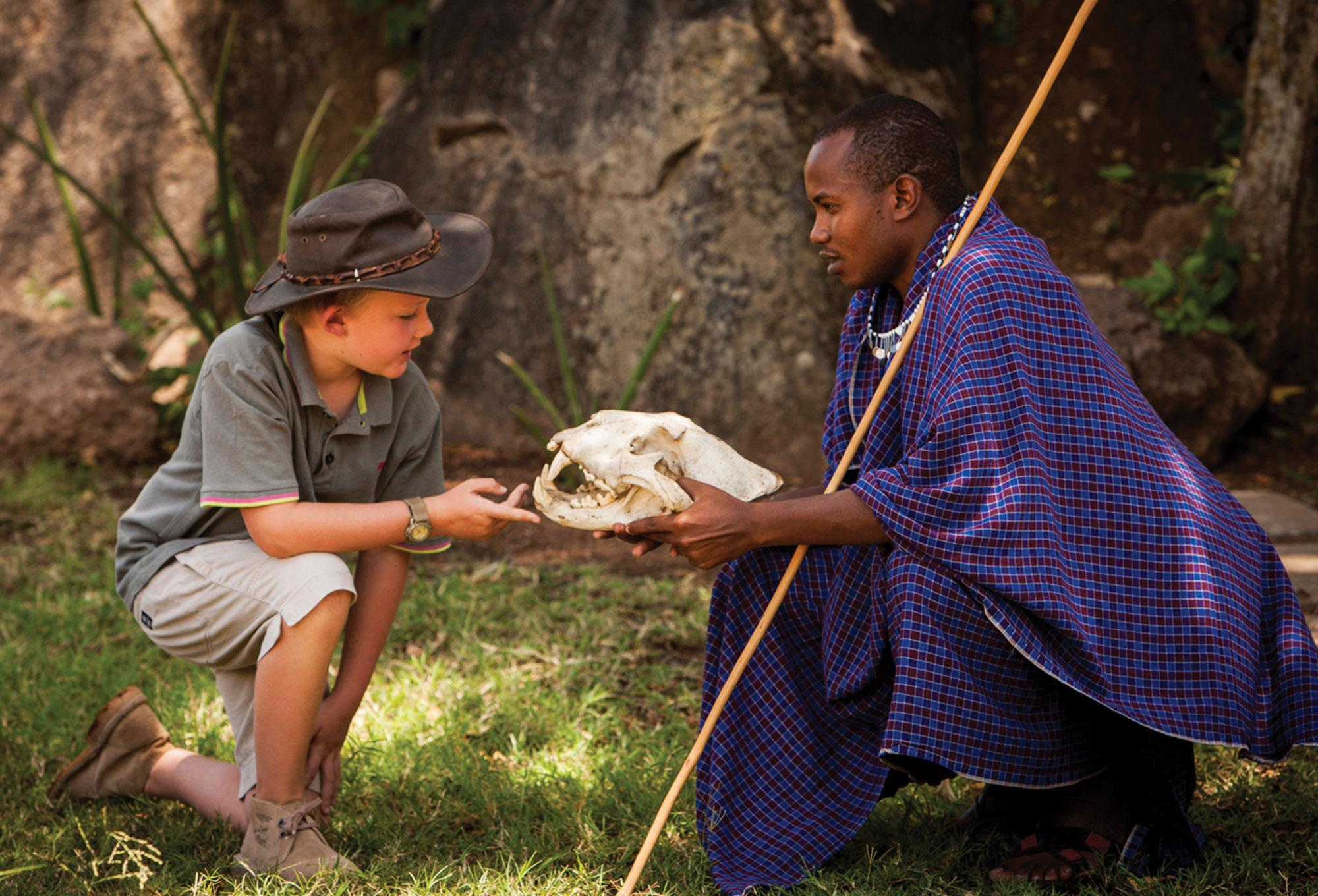 Annual collection of facts opinions and trivia about travel four seasons safari lodge serengeti arusha santzania kids learn bush skills beading and swahili from maasai warriors publicscrutiny Image collections