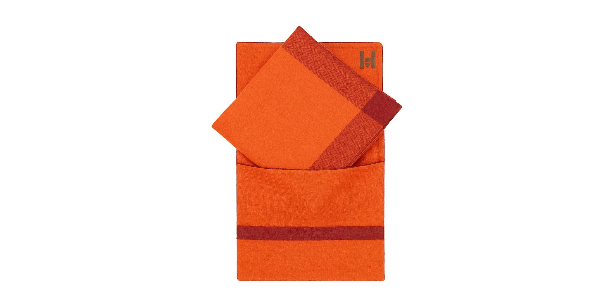 A hand-woven 100 percent cashmere travel blanket and case from Hermès