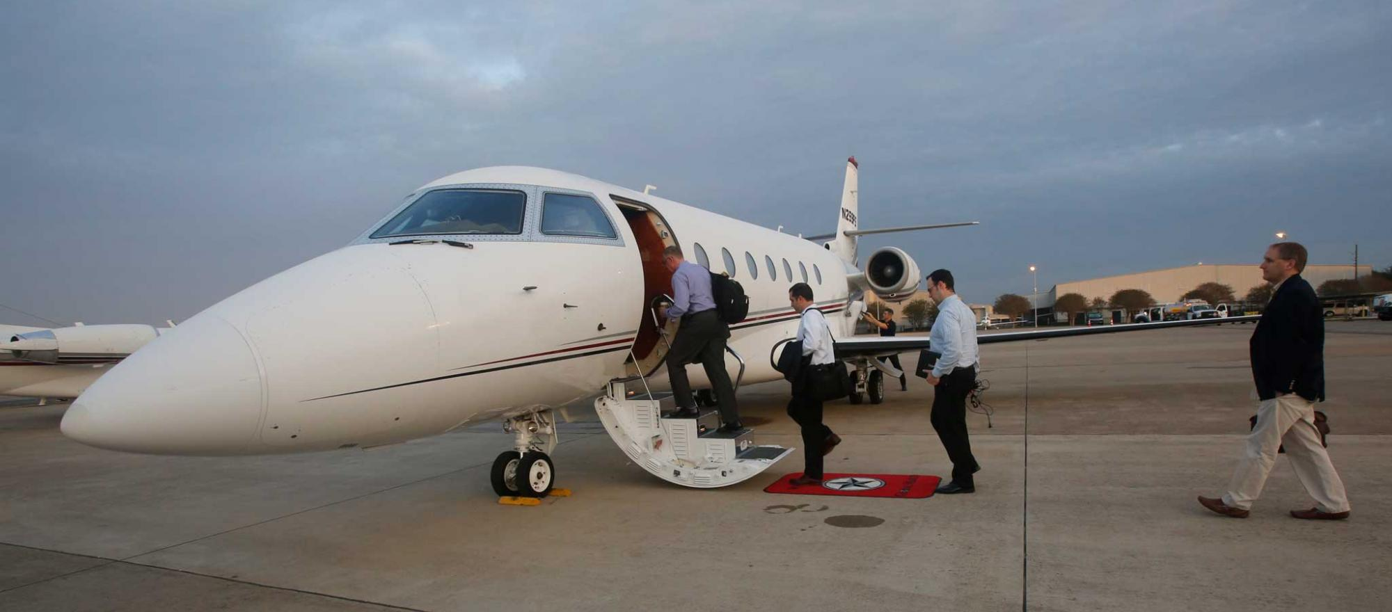 People getting into private jet