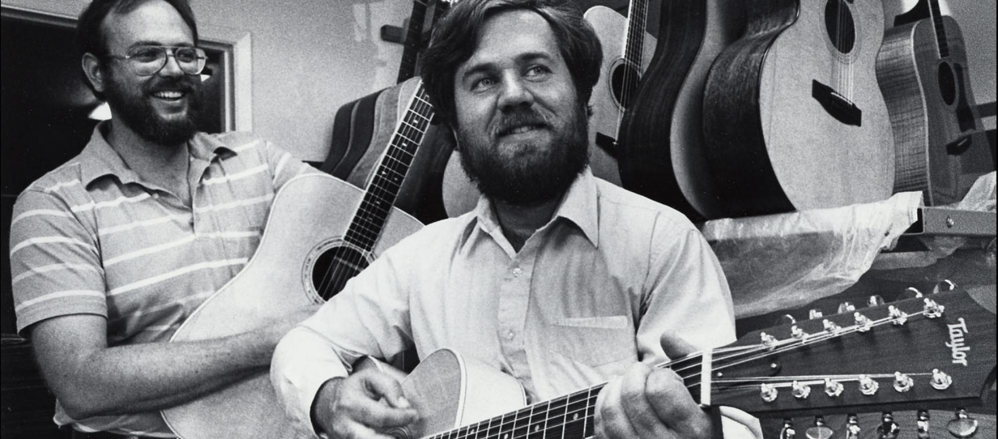 Bob Taylor (left) and Kurt Listug, shown here in 1985, launched their guitar-building business more than 40 years ago.