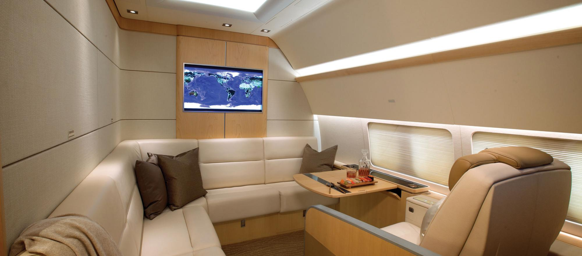 Luxury interior of a Boeing BBJ with pod seats.