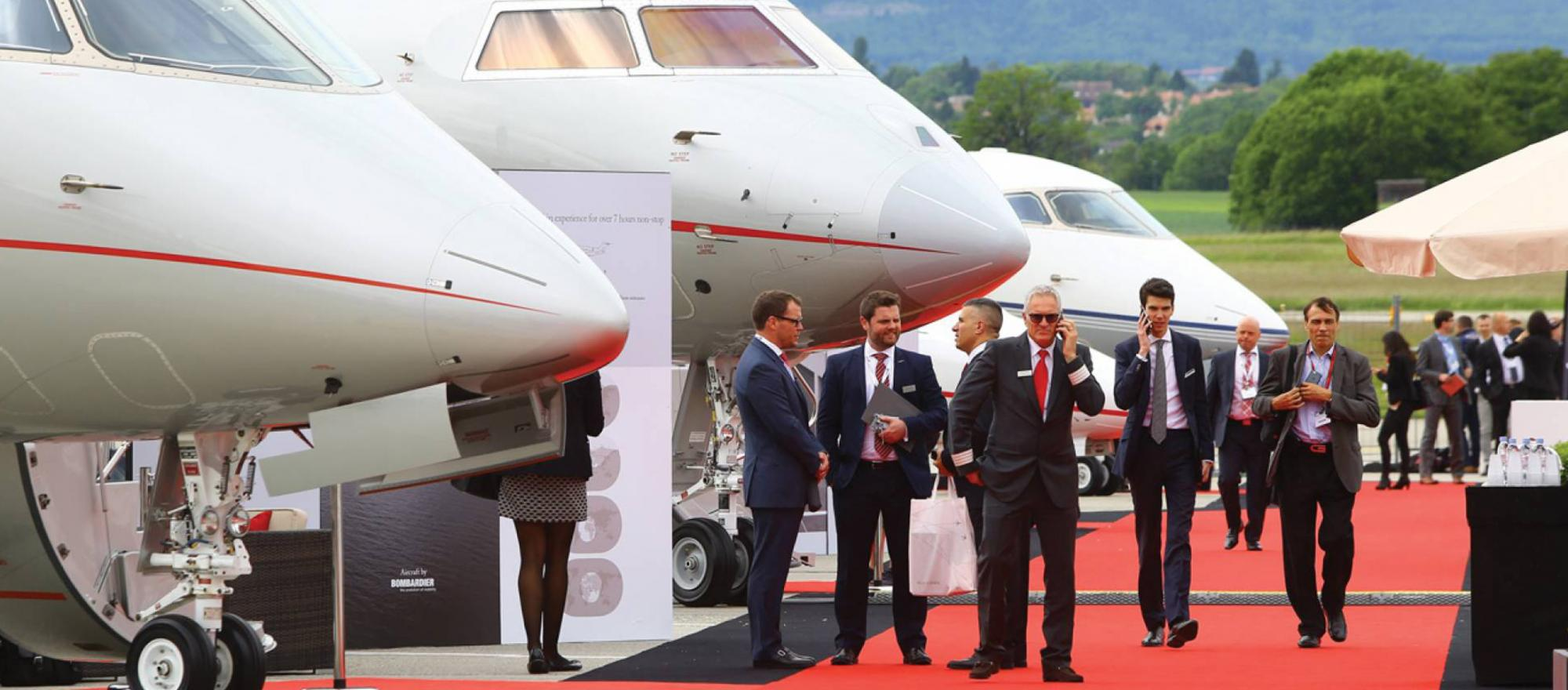 Business jets and people.