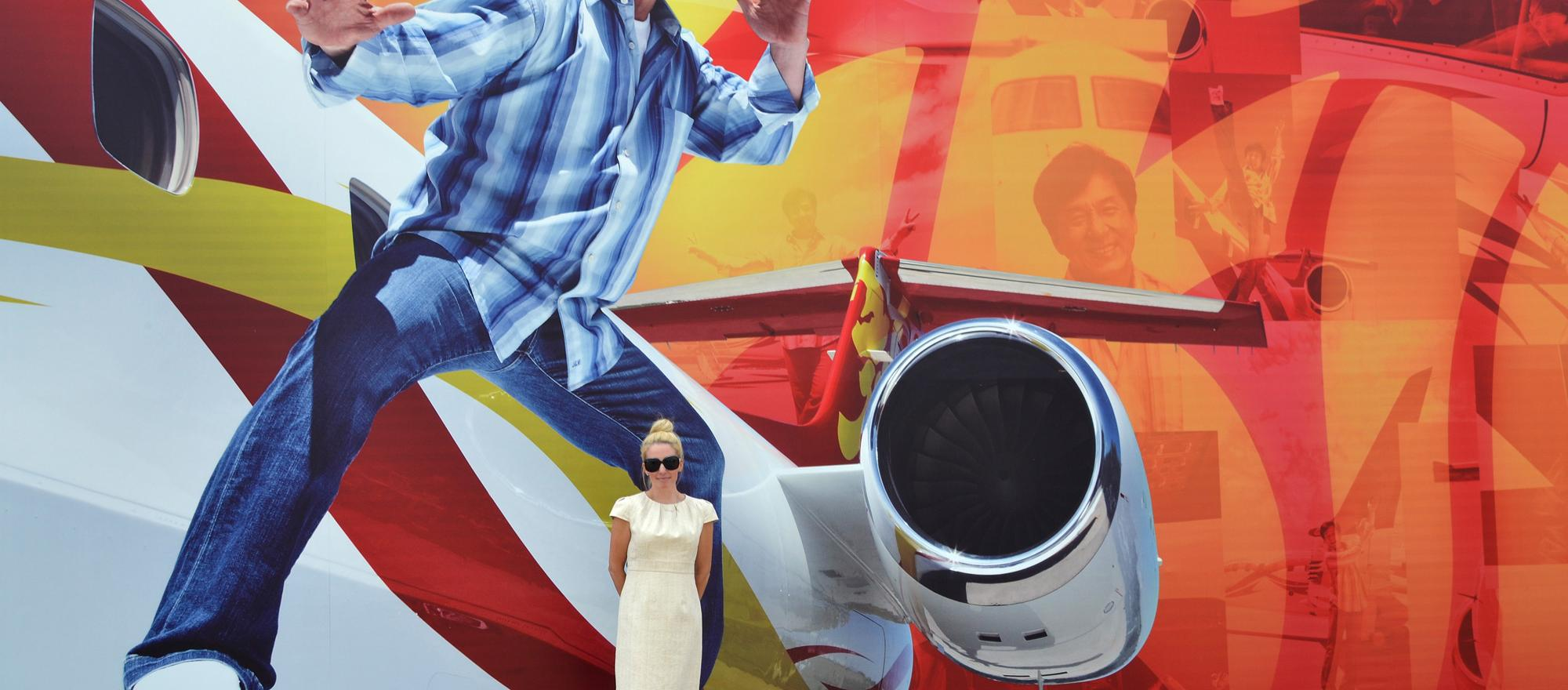 BJT's editorial director Jennifer Leach English in front of a Jackie Chan display (photo: Mona L. Brown)