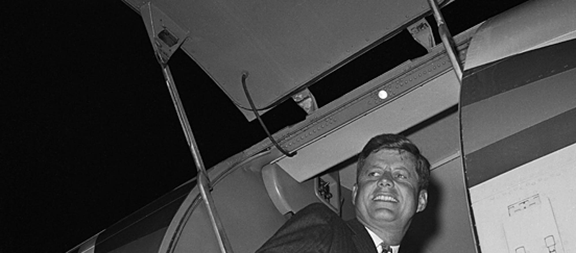 President-elect John F. Kennedy enters his airplane in 1960