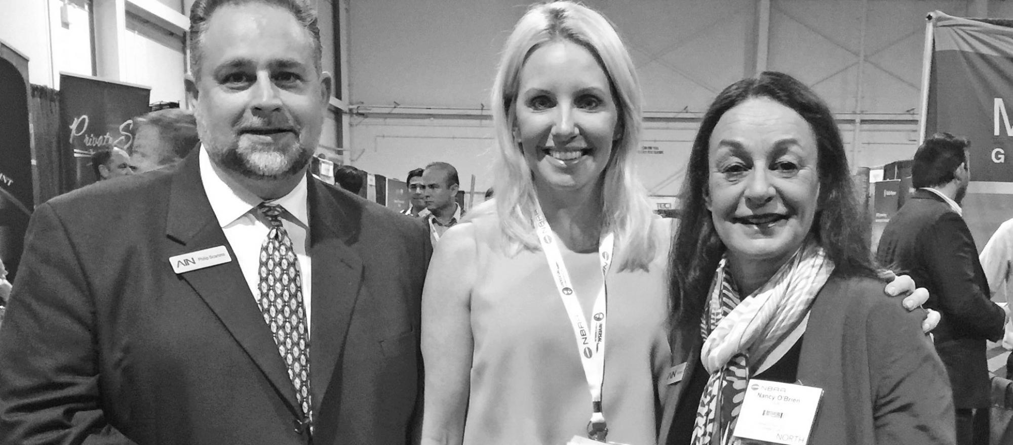 Jennifer Leach English (center) with BJT's onsite logistics manager Philip Scarano and associate publisher Nancy O'Brien at the NBAA Regional Forum in West Palm Beach.