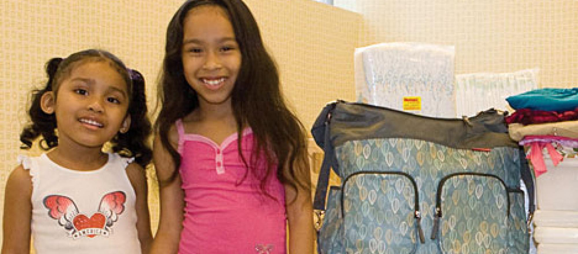 Two little girls with donations