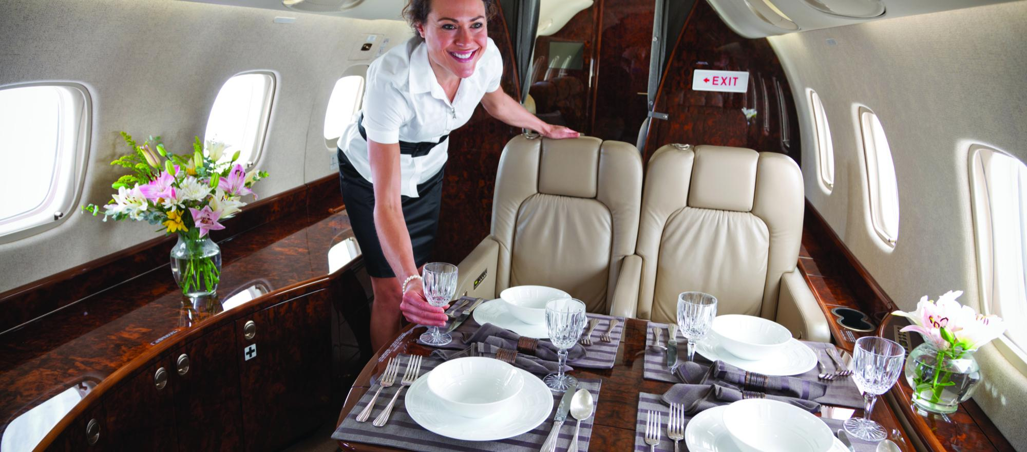 Flight attendants prepare and serve gourmet meals, help passengers navigate entertainment systems and provide life-saving help in an emergency. (Photo: TWC Aviation)
