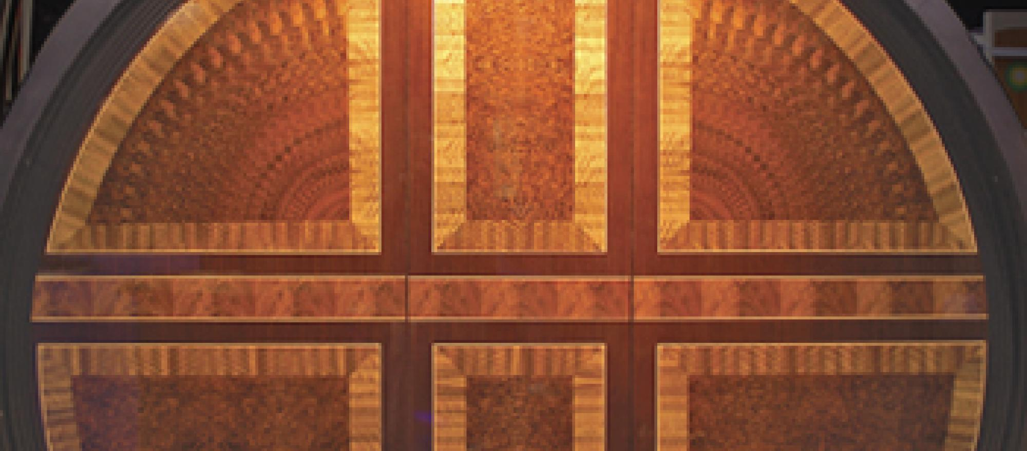 This hand-cut marquetry contains mahogany and walnut veneers and maple edging