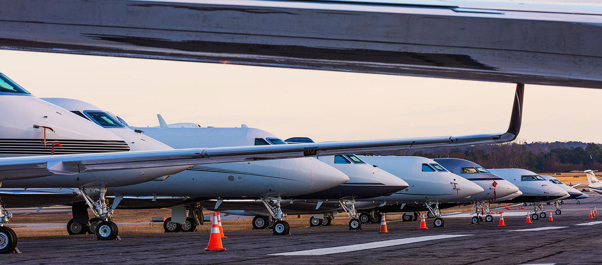 Business jets on the ramp.