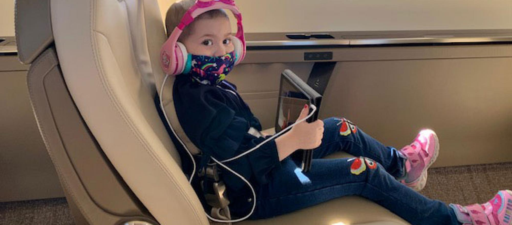 Girl in business jet seat