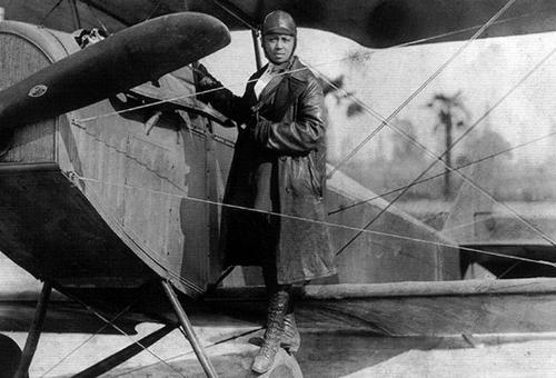 Bessie Coleman and her airplane in 1922