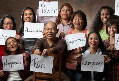people holding signs of hope