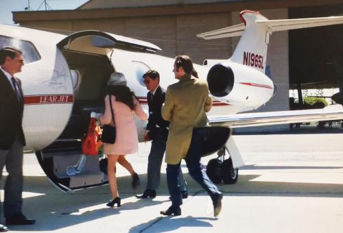 People boarding a aircraft