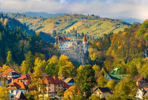 Panoramic view over Bran Castle (commonly known as Dracula's Castle). Photo: Adobe Stock
