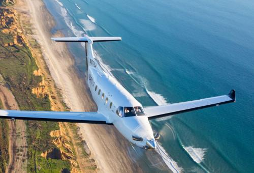 Business Jet Flying To Illustrate Flying Privately Through Membership Clubs