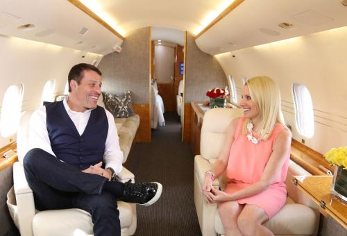 Tony Robbins talks with Jennifer Leach English aboard his new jet. Photo: Cy Cyr