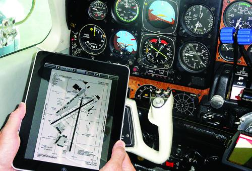 Charts, operating manuals and maintenance data that used to weigh up to 80 po