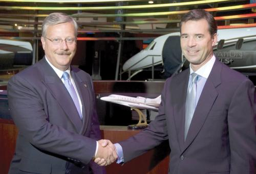 Cessna CEO Jack Pelton (left) inks a big deal with XOJet CEO Paul Touw.