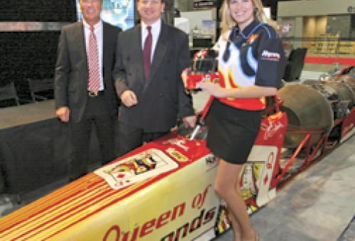 Race car driver Jesse Harris with BizJet International's Bern Kowalewski and,