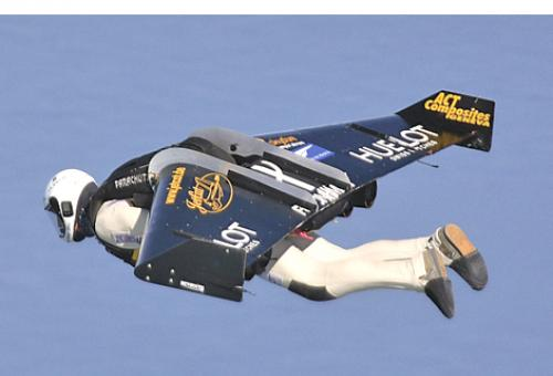 Yves Rossy flew over the English Channel with a wing that he steers by moving