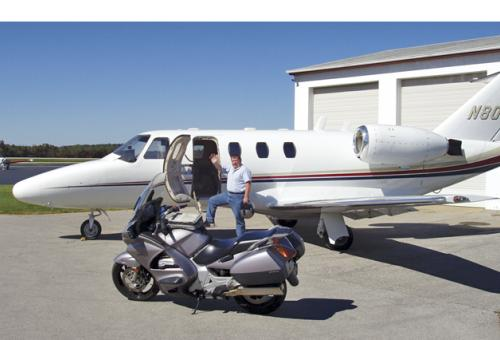 Ride and Fly president John Garwood with a Beechjet charter and his own road