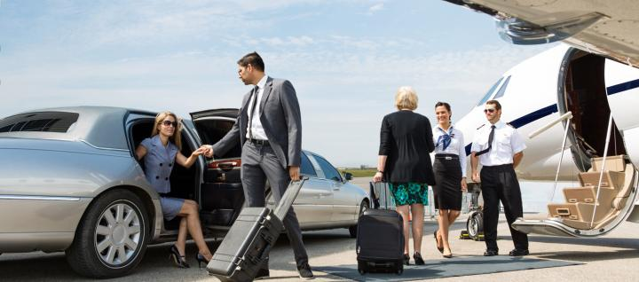 People boarding a private jet.